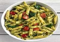 Penne pasta with pesto and cherry tomato