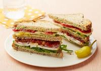 Greek vegetable sandwich with multigrain bread and fries