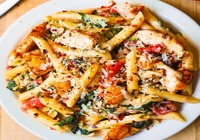 Chicken pasta with fresh vegetables and house made bread