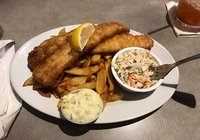 Cod fish  with potatoes chips and coleslaw