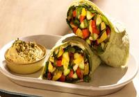 Grilled vegetable wrap with spicy hunmmus