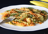 Three color pasta with spinach and olive in rose sauce